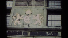 1982: twin lion crest on the wall, soldiers walking down the road DENMARK Stock Footage