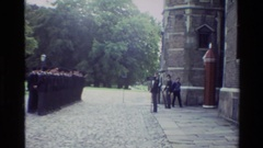 1982: military salute and changing of the guard at a castle with cobblestone Stock Footage