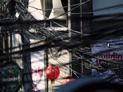 Tangled bundles of overhead wires. Electricity system on the streets of Maui Stock Footage