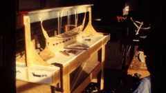 1982: indoor exhibit boat model wooden sailing ship DENMARK Stock Footage