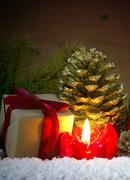 Advent candle and gift box. Stock Photos