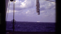 1982: a rope swings on a line on a boat as it sails in the sea DENMARK Stock Footage