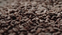 Quality of grain roasted coffee to spill in the bag , slow motion Stock Footage