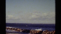 1982: smooth bluish waves and calm and cloudy sky of a day on sea DENMARK Stock Footage