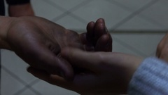 Homeless Man: Hold hands of Young Girl Stock Footage