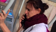 Young Girl Talking in Telephone Booth Stock Footage