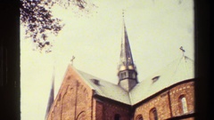 1982: spires tower high above the roof of the stone cathedral DENMARK Stock Footage