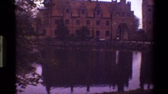 1983: two big buildings as same as a palace with a small lake on the front in Stock Footage