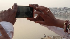 Close up of romantic couple taking photos on a mobile phone camera Pushkar, Raja Stock Footage