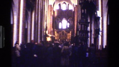 1982: view of visitors milling around in large, old, probably catholic church Stock Footage