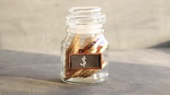 Saving money jar. Golden coins and tag Stock Footage