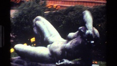 1983: two angle shots of a sculpture of a sorrowed naked woman. DENMARK Stock Footage