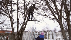Man saws off the apple tree branch Stock Footage