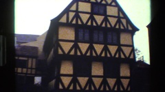 1983: a pan of the front of buildings that look to maybe be an old church in Stock Footage
