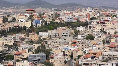 Pan: Skyline of Umm El Fahm, an Arab town with citizens of Israel. Stock Footage