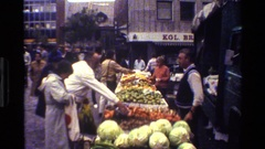 1983: another busy day in a farmer's market where many different kinds of food Stock Footage