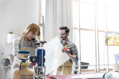 Stained glass artists working in studio Stock Photos