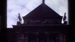 1983: exterior view of a monumental building, with its statues and a person Stock Footage