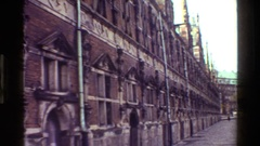 1983: long street building decorated with some bust lady statue DENMARK Stock Footage