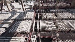 Crane hook moved above slabs on concrete factory Stock Footage