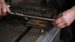 Worker measuring the detail with caliper closeup Stock Footage