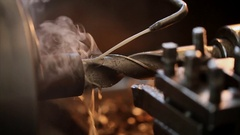 Drilling on lathe with coolant closeup Stock Footage
