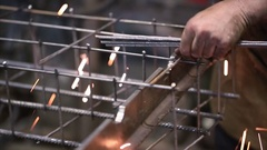 Worker welds reinforcement construction with spot welding closeup Stock Footage