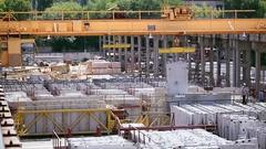 Crane lifts concrete slab on concrete factory Stock Footage