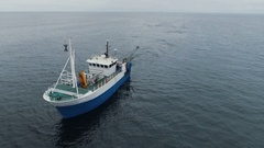 Flying over a Commercial Fishing Ship that Pulls Trawl Net Stock Footage