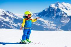 Ski and snow fun for child in winter mountains Stock Photos