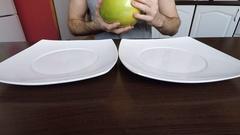 Man peels fruit pomelo Stock Footage
