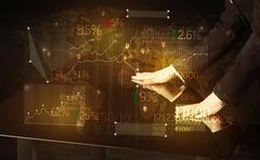 Hands navigate on high tech smart table with business icons Stock Photos
