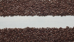 Composition for the title, spilled coffee beans and a Cup of coffee, Dolly shot Stock Footage