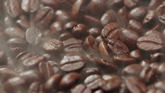 4K Aroma of coffee, Roasted Coffee Bean, rotation and rising smoke Stock Footage