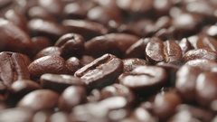 4K Aroma of coffee, Roasted Coffee Bean, rotation and rising smoke.macro Stock Footage