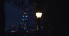 An establishing shot of New York City's Empire State Building at night - 4k Stock Footage