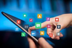 Fingers touching tablet with apps Stock Photos