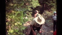 1981: a group of hikers enter the vegetation loading their backpacks BRITISH Stock Footage