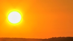 Sunset against the background of the orange sky. There are a few clouds. Stock Footage