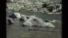 1981: some rocks in the middle of a flowing river BRITISH COLUMBIA Stock Footage