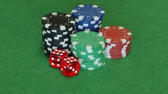 Poker chips and two red dice on table Stock Footage
