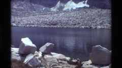 1981: a mountain next to a lake that in the middle of the day. BRITISH COLUMBIA Arkistovideo