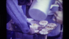 1981: workers gathered around to get breakfast and people serving food BRITISH Stock Footage