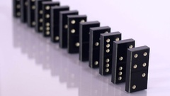 Falling black dominoes in slow motion Stock Footage
