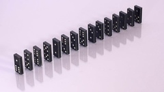 One domino knocks down whole line Stock Footage