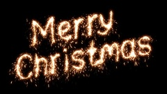 Beautiful Animation of Sparklers Text Appearing on Black. Merry Christmas Theme. Stock Footage