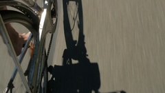 Drunk and careless cyclist on the road. Reflection shade bicycle on the road. Stock Footage
