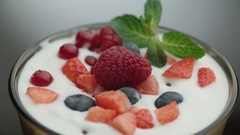 4K berry mix of strawberries, blueberries, red currants,raspberries in natural Stock Footage