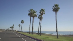 Driving along PCH in Huntington Beach, California on Pacific Coast Highway Stock Footage