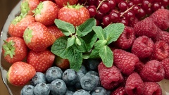 4K Fresh, ripe, juicy berry mix of strawberries, blueberries, red currants Stock Footage
